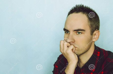 young-man-holds-her-chin-hand-pensive-pose-portrait-thinking-105050037.jpg