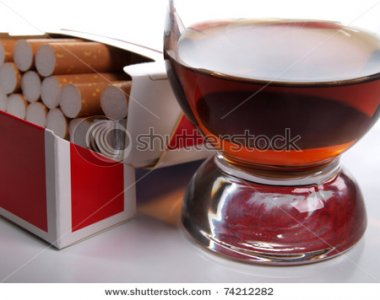 stock-photo-color-photo-of-a-glass-of-whiskey-and-a-pack-of-cigarettes-74212282.jpg
